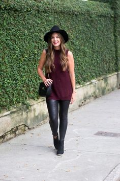To Style Spanx Faux Leather Leggings Perfect modern and chic city girl fall and winter outfit with black leggings, floppy brim hat, sleeveless tunic wine maroon sweater dress, ankle booties Legging Outfits, Leather Leggings Outfit, Cute Outfits With Leggings, Spanx Faux Leather Leggings, Sporty Outfits, Nike Outfits, Leggings Fashion, Fashion Outfits, Womens Fashion