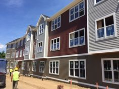 Eco-side Smooth, siding fit for any design. Beautiful work here for the UMass Amherst College Apartments by Western Builders. Engineered Wood Siding, Amherst College, Termite Damage, College Apartments, Exterior Siding, Carbon Footprint, Sustainable Design, Smooth, Mansions