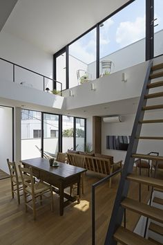Interior shot of a Japanese house hemmed on all four sides by its neighbours.
