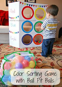 sorting, gross motor skill activity - love the idea of using a tri-fold board for things like this!