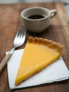 A lemon tart is a French dessert dish, a variety of tart. It has a pastry shell with a lemon flavored filling. In the UK, Lemon Tart (also called Tarte au citron) consists of a pastry case (often made in a fluted tart tin) containing a baked lemon custard (usually composed of eggs, sugar, lemon juice and cream).