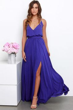 You're sure to be the eighth wonder of the world in the Rippling Reflection Indigo Maxi Dress! A lightweight woven fabric in a dazzling shade of indigo falls from small spaghetti straps into a surplice bodice (with modesty snap) and a modified racerback. Elastic waist is hidden by tying sash while a sweeping maxi skirt with two high front slits drapes below. Lined to mid-thigh. 100% Polyester. Hand Wash Cold. Imported.