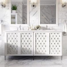 White mirrored dual double sink vanity with silver faucets on marble tile floor