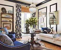 """""""This palette conveys a young at heart style, with a touch of sophistication,"""" says Brende, """"It would work well in a transitional environment."""" To create a look that spans two styles, apply modern finishes to classic elements (such as black lacquer to traditional trimwork) and juxtapose elements from both ends of the spectrum side-by-side (such as timeless navy blue swoop arm chair with a global patterned trim)./"""