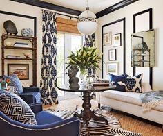 white sofa, navy chairs, pedestal table