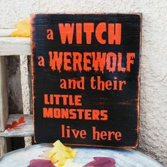 a witch, a werewolf and two little monsters live here-Halloween sign. I want to make my own colorful version of this!!