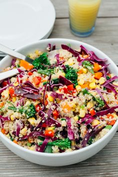 An Asian inspired Quinoa salad recipe bursting with the colors of the rainbow! Peppers, Corn, Baby Broccoli, Red Cabbage, Carrot and Quinoa, tossed in a Tahini Ginger Dressing. #rainbow #recipe #vegan #quinoa #glutenfree #tahini #ginger #healthy #simple #food