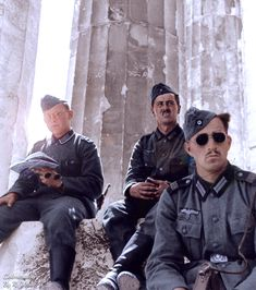 Wehrmacht soldiers rest in the shade of the Parthenon on the Acropolis in Athens Greece Spring 1941.