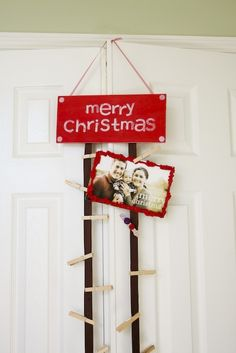 Doing this for sure. Add ribbon to a Christmas sign. Attach cards with clothes pins.