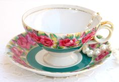 Vintage Tea cup and Saucer. Pink Roses Hand Painted Tea Cup