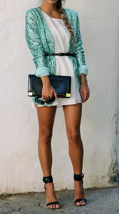 sparkly mint green jacket paired with a white mini and strappy black heels