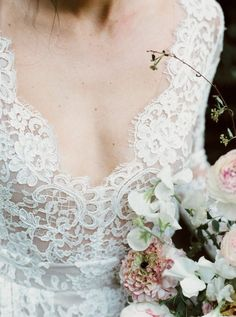 The beautiful lace on the dress is complimented by the soft edges of the white flowers in the bouquet!