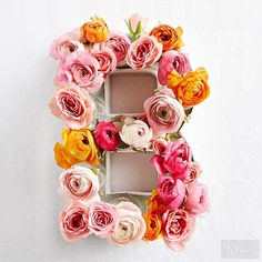 Get fresh flowers from your garden or the farmer's market to make these beautiful DIY decor and centerpiece items. These floral arrangements go way beyond a typical vase. See how to make a floral monogram, flower art and a DIY flower centerpiece.