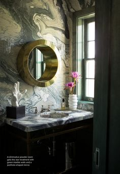 Gorgeous powder room. Look at that wall! Looks like giant-patterned marble. So striking.