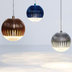 Tom Dixon's new Fin Pendant Lamp presented at the milan show next month--beautiful puddles of light