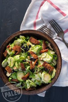 This Paleo Brussels Sprouts, Blueberry & Bacon Salad has crisp Brussels, sweet blueberries, savory bacon and tangy lemon tarragon dressing.