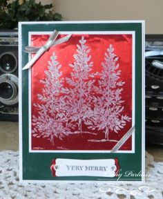 The Christmas Tree from SU!'s Lovely As A Tree Stamp Set was stamped onto the  Scarlet Red Craft Metal with White Craft Ink and embossed with Iridescent Ice Embossing Powder and a Heat Tool.  It was then layered onto a piece of Whisper White Cardstock and attached to the Garland Green Craft Metal piece.