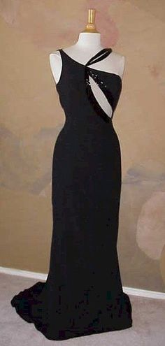 #black #blackdresses #pageant #gown #dress #dressesforsale #eveninggown   This unique evening gown was made in all black.  There are sheer insets on the bodice in front and back. The close up picture shows liquid beading on the edges of the keyhole design. We have other black evening dresses for sale. All formal gowns can be made with any changes and in any size.