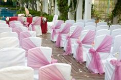 Tulle Decorations For Wedding Chairs. Not necessarily pink, but I like the idea. Tulle Decorations, Church Wedding Decorations, Wedding Church, Wedding Reception, Wedding Aisles, Decor Wedding, Diy Wedding, Folding Chair Covers, Purple Chair