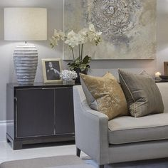 """Formal sitting room with grey and a subtle hint of orange """