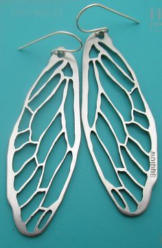 silvery cicada earrings in sterling silver and laser cut steel