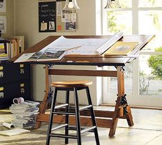 The first piece of furniture in the Studio: a Drafting Table. In addition to a small Taboret or Cart for Drawing materials.