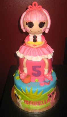 Lalaloopsy. Doll is edible! Tons of stiching and buttons around the cake. Click on it if you want to see a different view on Cakecentral!