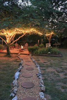 lights in trees surrounding firepit