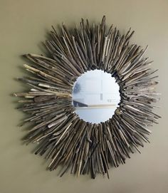 DRIFTWOOD MIRROR: 48-inch circular mirror made from driftwood collected at Barker Reservoir, Nederland Colorado