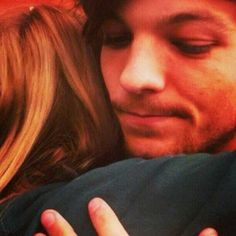 Louis with a fan before the game. This is a perfect picture. <3 <3