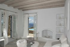 Villa Ammonite is a 4 bedroom Villa in Psarou with private pool and is part of Diles Villas, a collection of vacation rentals in Mykonos. Mykonos Island Greece, Mykonos Villas, Vacation Villas, Vacation Rentals, Villa With Private Pool, Spacious Living Room, Outdoor Living Areas, Ammonite