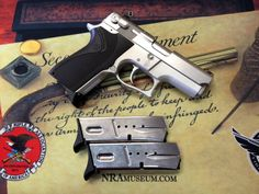 Smith & Wesson Model 6906 in 9x19mm. Comes with three 10-round magazines and a soft case.