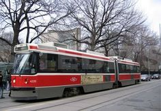 Wrong trolley (this one is from Canada) but nice angle and trees