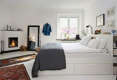 Bed with storage drawers and shelves behind the headboard