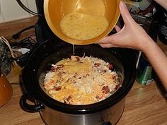 Layer one 32 oz bag frz hash browns, 1 lb cooked/crumbled bacon, 1 lb cooked/crumbled sausage, chopped onions, and 3 cups cheese in the crockpot in three layers.   Beat 1 doz eggs, 1 cup milk and 1/4 tsp dry mustard, salt & pepper together.   Pour over the whole mixture.    Cook with slow cooker on low for ten to twelve hours or until eggs are set