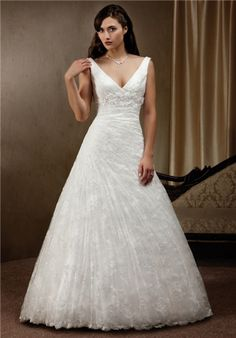 Tulle and Satin A-line wedding dress with V-neck front and back. Tank style straps with beaded and e