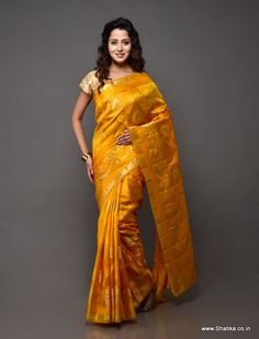 Rolling in class is this spirited bright yellow tussar silk saree with gold brocade work all over. Pertinent to our collection of Banaras Tussar Silk Sarees online, this Banarasi Silk Saree is from Banaras - the spiritual capital of India.