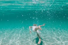 Claire & Chris. Underwater wedding photo session in the crystal clear waters of Eagle Bay. Underwater photos wedding Photocredit : photogerson. Eagle Bay Western Australiaunderwater photo underwater model underwaterwedding underwater photoshoot beach wedding ocean wedding tropical wedding