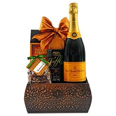 Tiny bubbles and a delightful experience await inside this bottle of Veuve Clicquot Ponsardin Brut Champagne!