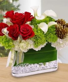 Red Roses, white Calla Lilies, pine cones & more make up this stunning bouquet. - By Beneva Flowers #Sarasota #Florist