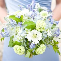Victoria Clausen/Romance of Flowers  Gathered hydrangea, viburnum, laced artemisia and muscari blooms complemented the cornflower-blue bridesmaid dresses.