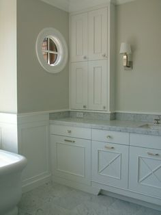 "Love the way this 4"" backsplash on the vanity is finished with a piece of molding."