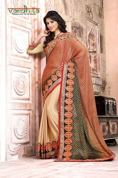 Cream & red color viscose + georgette fabric designer saree comes with cream color art silk fabric blouse. This saree has floral embroidery in pattli to pallu with lace border all over saree. It comes with golden blouse which can be stitch up to size 44.  http://www.vardhita.co.uk/product/cream-red-color-viscose-georgette-saree-77-5555/