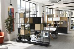 This grid zone divider in a mid-century modern design is a brilliant solution to achieving division in an open plan space. It can be customised to a workspace with multi-purpose storage and display shelves.