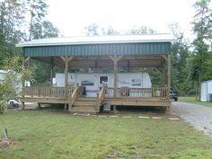 Green metal RV Shelter with wooden deck. Camper Life, Rv Life, Rv Shelter, Rv Carports, Metal Shop Building, Rv Garage, Garage Ideas, Rv Homes, Tiny Homes