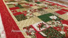 Christmas quilt made by Phyllis S. Longarmed by Le Ann Weaver of Persimmon quilts.