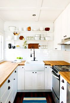 The Most Stylish IKEA Kitchens We've Seen via @mydomaine Open shelves and expert styling make this kitchen a stunner, but we can't take our eyes off the industrial faucet, rich wood counters, and generous farmhouse sink, all of which were scored at IKEA.