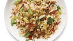 Lemony Orzo with Tuna | Martha Stewart Living - This bright, summery recipe is a great dinner, but makes for equally tasty lunch leftovers. #orzorecipe #tunarecipe #summmerrecipe