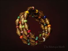 Paper bead bracelet by TheMistiqueMoth on Etsy, $18.00