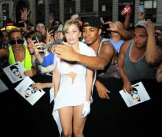 Lady Gaga takes a photo with fans outside of 'Good Morning America' in New York City.